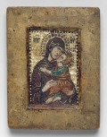 "Portable Mosaic Icon with the Virgin Eleousa, early 14th century Byzantine, probably Constantinople Miniature mosaic set in wax on wood panel with gold, multicolored stones, and gilded copper tesserae; some portions restored 4 3/8 x 3 3/8 in. (11.2 x 8.6 cm) Gift of John C. Weber, in honor of Philippe de Montebello, 2008 (2008.352) In the fourteenth century, Byzantine artists developed a new art form: micromosaics worked in exceptionally tiny tesserae in a painterly style. These intimate images were made primarily for use in private devotions, and few of them survive. The Museum's micromosaic, which depicts the Virgin Eleousa, the Virgin of Compassion, emphasizes the humanness of the Christ Child, as he reaches forward to touch his head to his mother's cheek. The Virgin lovingly embraces her son, while her mournful gaze invites the viewer to contemplate his future sacrifice and death. On the reverse of this mosaic is an inscription in a late fifteenth-century Humanist hand that identifies it as the icon that moved Saint Catherine of Alexandria to convert to Christianity in the fourth century. Such labels attest to the popularity of micromosaics in the Latin West, where, during the Renaissance, they were often inaccurately dated to the first Christian centuries. This icon first came to scholarly attention when it was lent to the Museum's 2004 exhibition ""Byzantium: Faith and Power (1261–1557)."" Related"